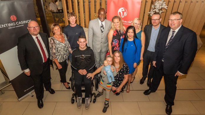 Finn Lusty, Frank Bruno, his family, and Genting UK and CHIPS staff at a Genting UK wheelchair handover.jpg