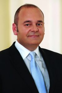 Christian Cardona Minister for the Economy Investment and Small Business